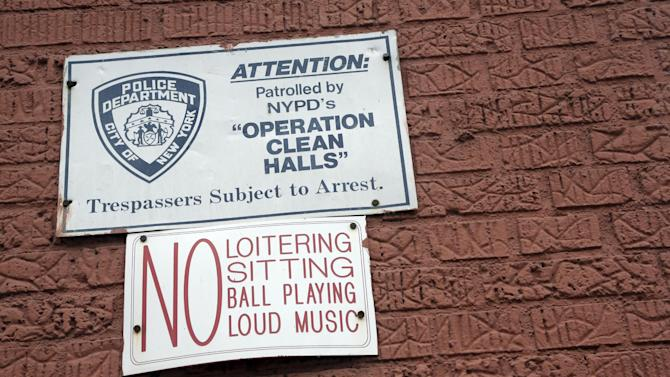 """In this Wednesday, March 6 2013 photo,  a sign is posted on the wall of a building in the Bronx borough of New York.   The building is one of thousands of private dwellings patrolled by the New York Police Department under a program known as """"Operation Clean Halls."""" (AP Photo/Mary Altaffer)"""