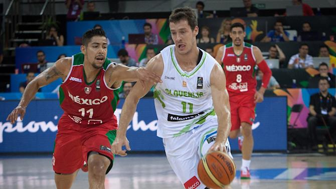 Slovenia's guard Goran Dragic (R) vies with Mexico's forward David Meza during the 2014 FIBA World basketball championships in Gran Canaria on August 31, 2014