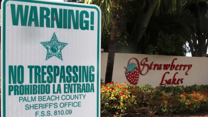 "FILE - In this Friday, March 16, 2012 file photo, a ""No Trespassing"" sign is shown in front a neighborhood of 262 homes called Strawberry Lakes, in Lake Worth, Fla. National foreclosure trends took a positive turn in April, as the number of homes seized by banks declined and fewer properties entered into the foreclosure process RealtyTrac Inc. said Thursday May 17, 2012. But state-level data point to potentially more home repossessions ahead in Florida and many of the 25 other states where courts are required to sign off on foreclosures. (AP Photo/Wilfredo Lee)"