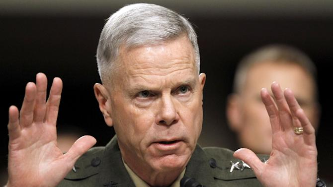 FILE - In this Dec. 3, 2010, file photo Marine Crops Commandant Gen. James Amos testifies on Capitol Hill in Washington. The Marine Corps commandant said Thursday Jan. 31, 2013, the infantry side is skeptical about how women will perform in those units and some positions may end up being closed if not enough females fail to meet the rigorous standards. (AP Photo/Alex Brandon, File)