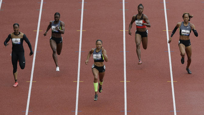 Allyson Felix, center, leads the pack in the women's 200 meter final at the U.S. Olympic Track and Field Trials Saturday, June 30, 2012, in Eugene, Ore. At rear, from left, are Carmelita Jeter, Jeneba Tarmoh, Tianna Madison and Sanya Richards-Ross. (AP Photo/Charlie Riedel)