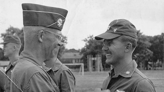 """ADVANCE FOR USE SUNDAY, NOV. 11, 2012 AND THEREAFTER - In this 1963 photo from the U.S. Army, Gen. Joseph Stilwell Jr. awards Richard Olsen with the Air Medal at Bien Hoa, South Vietnam. Olsen moved beyond Vietnam to an artistic career that has spanned more than 50 years; he's produced more than 1,000 paintings, many of them abstract. His work has been shown in galleries around the country. Yet those days when he flew his chopper over the dense thicket of jungle maintain a deep hold on him. """"War is the depth of the human experience,"""" he says. """"It's the most meaningful part of anyone's life."""" (AP Photo/U.S. Army)"""