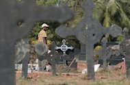 <p>Workers prepare the gravesite of Jacintha Saldanha at a cemetary in Shirva on December 16, 2012. Family and friends of Saldanha, the nurse who was found hanged after taking a hoax call to the hospital treating Prince William's wife, prepared for her funeral in India on Monday.</p>