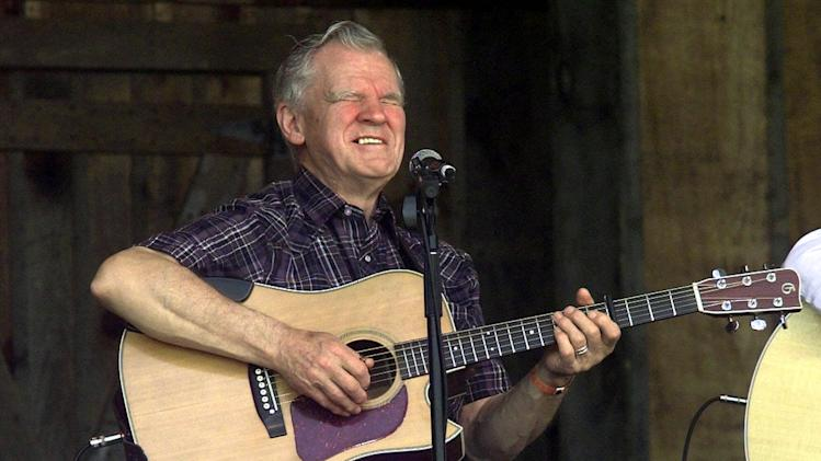 FILE - In this April 28, 2001 file photo, Music legend Doc Watson performs at the annual Merlefest at Wilkes Comunity College in Wilkesboro, N.C. Watson was in critical condition Thursday, May 24, 2012 at a North Carolina hospital after falling at his home in Deep Gap earlier this week.  (AP Photo/Alan Marler, File)