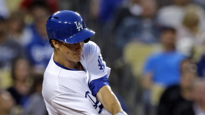 Los Angeles Dodgers pitcher Zack Greinke hits an RBI single against the Washington Nationals in the second inning of a baseball game in Los Angeles on Wednesday, May 15, 2013. (AP Photo/Reed Saxon)