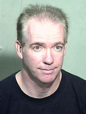In this undated photo provided by the Maricopa County Sheriff's Office, 53-year-old Michael Marin is shown. The former Wall Street trader and attorney is suspected of fatally poisoning himself as he was found guilty of arson of an occupied structure in a Phoenix courtroom on June 28, 2012. (AP Photo/Maricopa County Sheriff)
