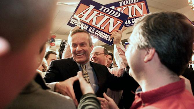 """FILE - In this Nov. 7, 2000 file photo, Missouri 2nd District candidate state Rep. Todd Akin, R-Mo., is congratulated by his supporters upon his victory over Sen. Ted House,  D-St. Charles in Kansas City, Mo. Until this week, Rep. Todd Akin was virtually unknown beyond his district, associated more with his deep religious convictions than any legislative achievements. Long before his comments about women's bodies and """"legitimate rape"""" made him a flashpoint in the fall campaign, this congressional backbencher was a favorite among home-schooling organizations and conservative church groups.  (AP Photo/St. Louis Post-Dispatch, Karen Elshout)"""