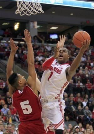 Thomas scores 25 to lead No. 11 Buckeyes, 58-49