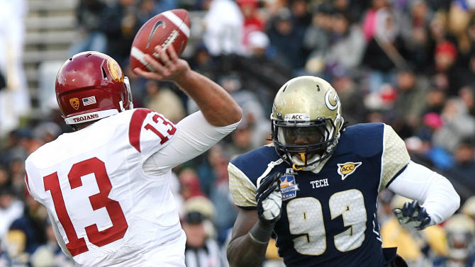 Southern California quarterback Max Wittek (13) is rushed by Georgia Tech defensive end Emmanuel Dieke (93) during the Sun Bowl NCAA college football game, Monday, Dec. 31, 2012, in El Paso, Texas. Georgia Tech won 21-7. (AP Photo/Mark Lambie)