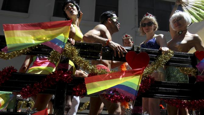 Participants in the Gay Pride Parade pose for picture before the start of the parade in New York, Sunday, June 24, 2012. The parade was held one year to the day of same-sex marriage being legalized in New York state. (AP Photo/Seth Wenig)