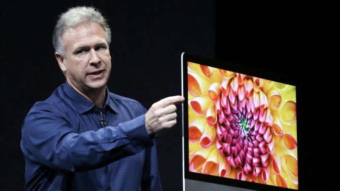 Phil Schiller, Apple's senior vice president of worldwide product marketing, talks about the thinness of the new iMac in San Jose, Calif., Tuesday, Oct.  23, 2012. The audience cheered as Schiller unveiled the new iMac computers. Schiller says the fusion drive will have the speed of flash and the capacity of regular hard drives.  (AP Photo/Marcio Jose Sanchez)