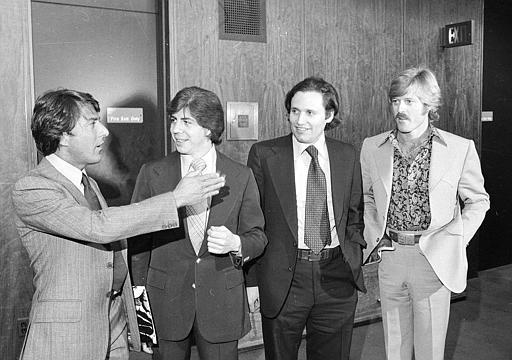 """Washington Post reporters Carl Bernstein, second from left, and Bob Woodward, third from left, are flanked by actors Dustin Hoffman and Robert Redford as they attend the premiere of the motion picture """"All the President's Men,"""" in Washington, D.C., on April 5, 1976. The film is based on the two reporters' book documenting their investigation of the Watergate Scandal. (AP Photo)"""