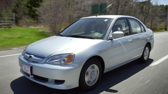 FILE - This April 25, 2002 file photo shows the Honda Civic Hybrid in Saco, Maine. More than 1 million vehicles in North America are part of a worldwide recall for an airbag problem affecting three big automakers. Toyota, Honda and Nissan are recalling more than 2 million vehicles because the inflator on the passenger side may burst, sending plastic pieces flying. Some of the vehicles being recalled are the Honda Civic, Toyota Corolla, Tundra and Lexus SC built between November 2000 and March 2004. (AP Photo/Robert F. Bukaty, File)
