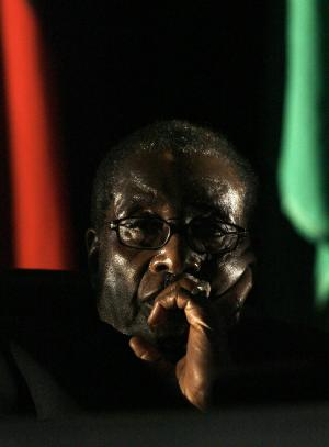 FILE - In this Aug. 17, 2008 file photo, Zimbabwe's President Robert Mugabe is seen at the closing ceremony of the 28th Southern African Development Community summit of heads of state and government, in Johannesburg, South Africa. A South African judge on Tuesday, May 8, 2012 ordered prosecutors to investigate whether Zimbabwean President Robert Mugabe's government committed human rights abuses, saying it would benefit Zimbabweans tortured in their homeland and South Africans determined to see their own government live up to its international responsibilities. (AP Photo/Jerome Delay, File)