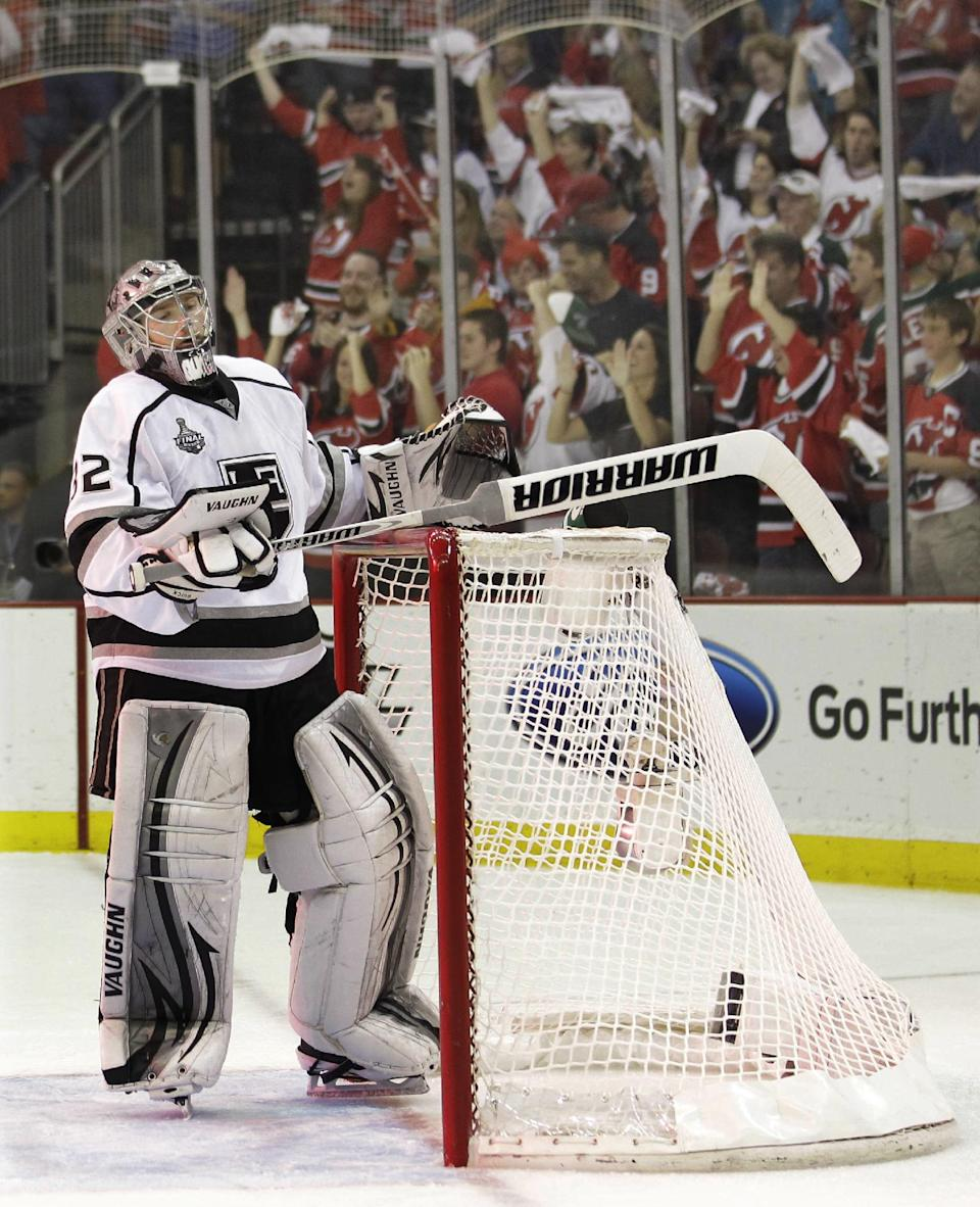 Los Angeles Kings' Jonathan Quick pauses after a goal was scored by New Jersey Devils' Bryce Salvador in the second period during Game 5 of the NHL hockey Stanley Cup finals, Saturday, June 9, 2012, in Newark, N.J.. (AP Photo/Julio Cortez)