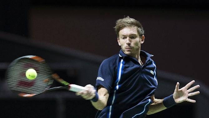 Nicolas Mahut of France returns the ball to Viktor Troicki of Serbia in the quarter-finals of the ABN AMRO Rotterdam World Tennis Tournament in Rotterdam, on February 12, 2016