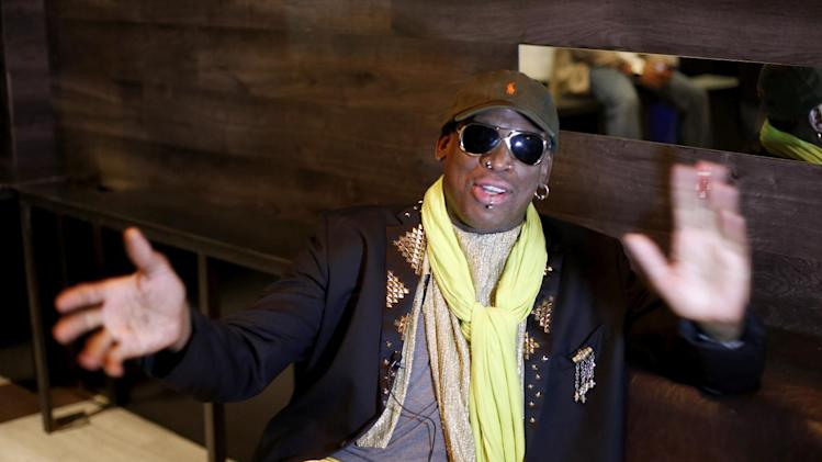 "In this Thursday, Nov. 21, 2013 photo, Dennis Rodman gestues during an interview after a promotional event to pitch a vodka brand in Chicago. Rodman looked fit and at ease, not squirming even once _ a childhood habit that earned the nickname ""The Worm."" He said he wouldn't talk about his relationship with Kim or North Korean politics, including its horrific human-rights record and secretive nuclear weapons program.(AP Photo/Charles Rex Arbogast)"