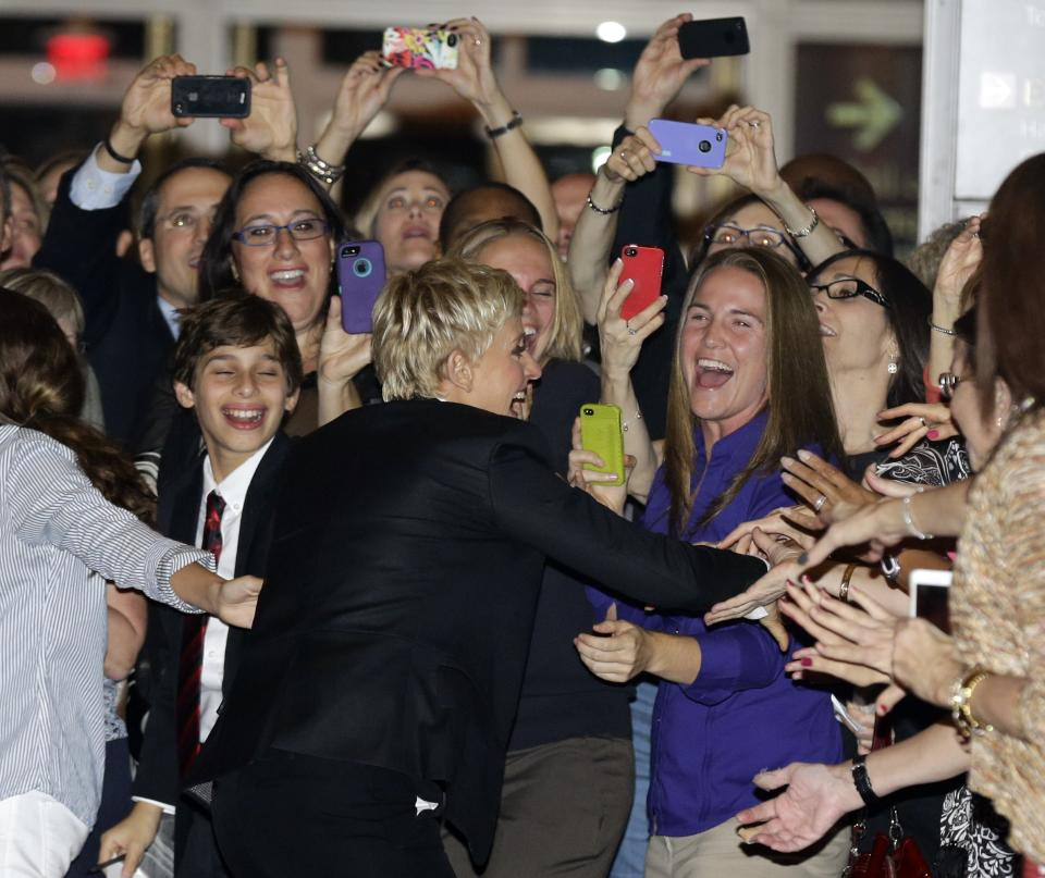 Entertainer Ellen DeGeneres, center, greets fans on the red carpet before receiving the 15th annual Mark Twain Prize for American Humor at the Kennedy Center, Monday, Oct. 22, 2012, in Washington. (AP Photo/Alex Brandon)
