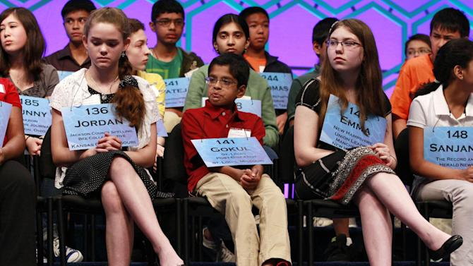 From left, Jordan Hoffman, 14, of Lee's Summit, Mo., Gokul Venkatachalam, 11, of Chesterfield, Mo., and Emma Ciereszynski, 14, of Dover, N.H., wait for their turn to spell in the semifinals of the National Spelling Bee, Thursday, May 31, 2012, in Oxon Hill, Md.  (AP Photo/Jacquelyn Martin)