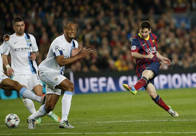 Barcelona's Lionel Messi, right shoots on goal during a Champions League, round of 16, second leg, soccer match between FC Barcelona and Manchester City at the Camp Nou Stadium in Barcelona, Spain