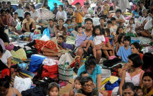 Hundreds of residents of suburban Manila take shelter in a basketball court due to severe flooding in Manila on August 6, 2012. Schools, financial markets and most government offices were shut as key roadways in Manila -- a metropolis of some 15 million people -- were made impassable by waters that in some areas reached neck-deep