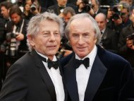 "Director Roman Polanski (L) and former Formula One champion driver Jackie Stewart of Britain pose on the red carpet as they arrive for the screening of the film ""All is Lost"" during the 66th Cannes Film Festival in Cannes May 22, 2013.              REUTERS/Yves Herman (FRANCE  - Tags: ENTERTAINMENT SPORT)"