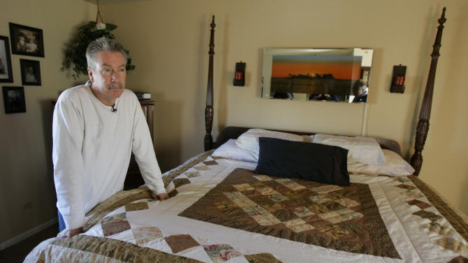 FILE - In this file photo taken Thursday, March 20, 2010 in Bolingbrook, Ill., Drew Peterson, who is on trial for the murder of his third wife Kathleen Savio in 2004, stands in the bedroom of the home from where his fourth wife, Stacy Peterson, disappeared from in 2007. Peterson's ongoing murder trial is heavily based on hearsay evidence, and has been complicated by a series of blunders by the prosecution team. As the trial heads into its fourth week it is anyone's guess which legal team holds the upper hand. Peterson is also a suspect in the 2007 disappearance of his fourth wife, Stacy , but never has been charged in her case. (AP Photo/M. Spencer Green) FILE