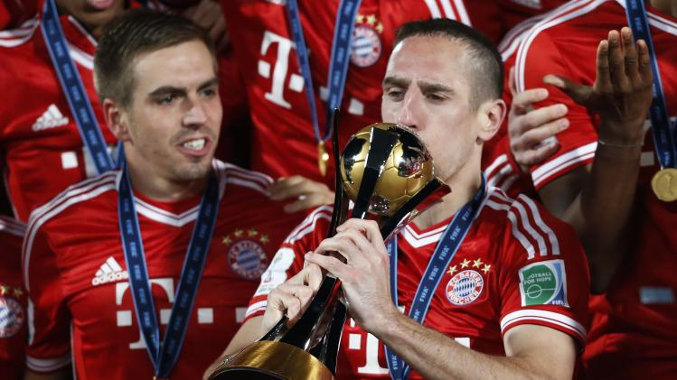 Germany's Bayern Munich Franck Ribery kisses the trophy as he celebrates with his team mates after winning their 2013 FIFA Club World Cup final soccer match against Morocco's Raja Casablanca at Marrakech stadium