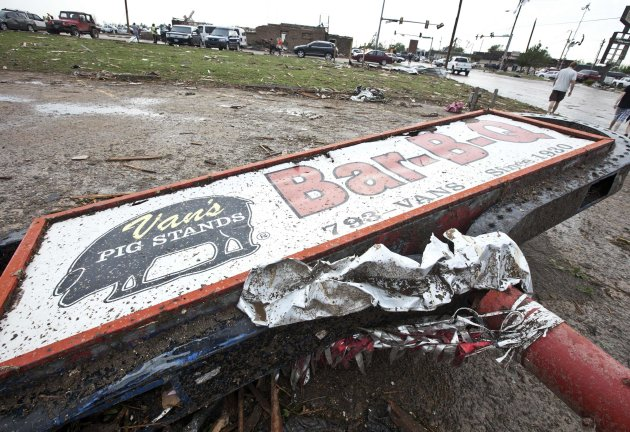 A sign for a local restaurant lies on the ground after a huge tornado struck Moore, Oklahoma