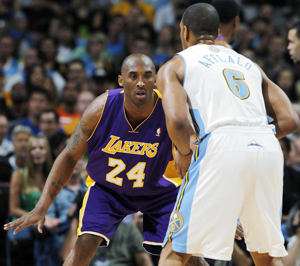 Los Angeles Lakers guard Kobe Bryant (24) drops back to defend against Denver Nuggets' Arron Afflalo in the first quarter of Game 3 of the teams' first-round NBA playoff series in Denver on Friday, May 4, 2012. (AP Photo/David Zalubowski)