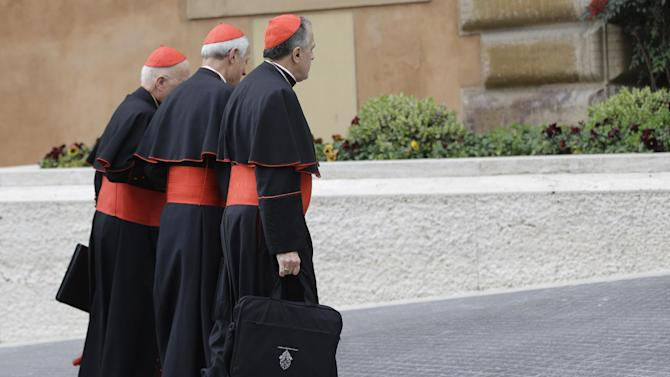 From left, US cardinals Francis George, Donald Wuerl and Daniel Di Nardo arrive for a meeting, at the Vatican, Tuesday, March 5, 2013. The Sistine Chapel closed to visitors on Tuesday and construction work got under way to prepare it for the conclave, but five cardinals remained AWOL from the preparatory meetings to discuss who should run the Catholic Church following Benedict XVI's resignation.The Vatican insisted nothing was amiss and that the five cardinals would be arriving in the coming days. (AP Photo/Andrew Medichini)