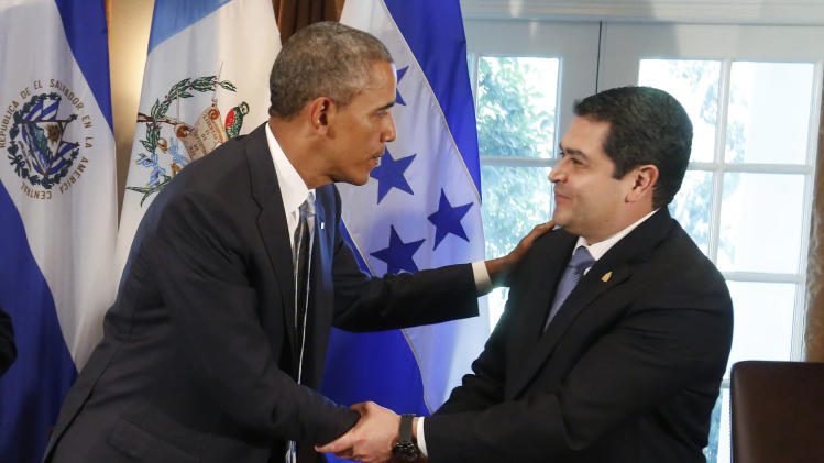 U.S. President Obama shakes hands with Honduras' President Orlando Hernandez after a meeting to discuss the flow of undocumented migrants to the U.S., in the Cabinet Room of the White House in Washington