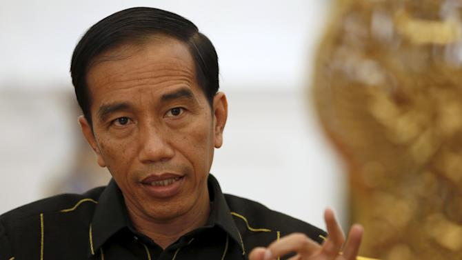 Indonesian President Joko Widodo gestures while speaking with Reuters during an interview at the presidential palace in Jakarta, Indonesia
