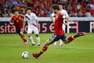 Spain's Xabi Alonso scores by penalty during their international friendly football match against South Korea at the Stade de Suisse stadium, in Bern. Spain won 4-1