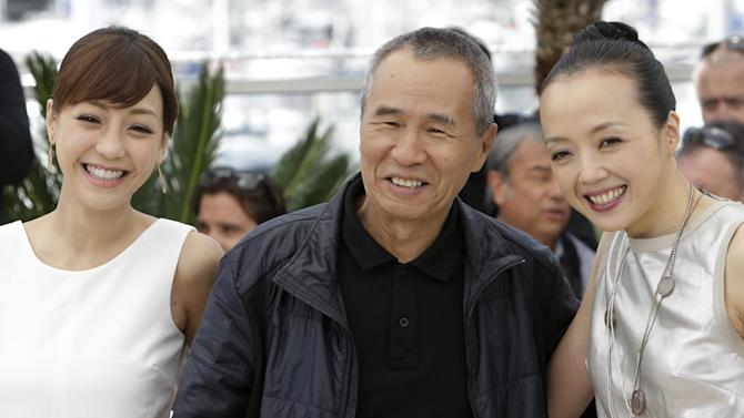 From left, actress Hsieh Hsin-Ying, director Hou Hsiao-Hsien, and actress Sheu Fang-Yi pose for photographers during a photo call for the film Nie Yinniang (The Assassin), at the 68th international film festival, Cannes, southern France, Thursday, May 21, 2015. (AP Photo/Lionel Cironneau)
