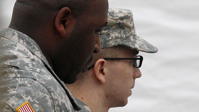 FILE -In this Tuesday, Saturday, Dec. 17, 2011 file photo, Army Pfc. Bradley Manning, right, is escorted into a courthouse in Fort Meade, Md., for a military hearing that will determine if he should face court-martial for his alleged role in the WikiLeaks classified leaks case. Visual journalists from many organizations have experienced difficulty capturing an unobstructed view of Manning entering and exiting a courthouse on the U.S. Army Post Fort Meade because of the often heavy security presence around him. (AP Photo/Patrick Semansky, File)