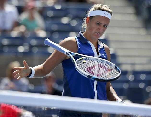 Victoria Azarenka, of Belarus, slams her racket down after losing a point against Ekaterina Makarova, of Russia, during the quarterfinals of the 2014 ...
