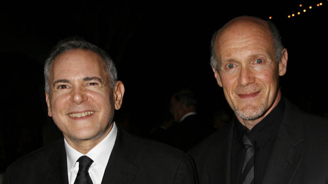 """FILE - This Nov. 15, 2007 file photo shows Craig Zadan, left, and Neil Meron, producers of the film """"Hairspray"""" at the Santa Barbara International Film Festival's Kirk Douglas Award for Excellence in Film presented to actor John Travolta in Santa Barbara, Calif.  Academy management announced Thursday, Aug. 23, 2012, that Craig Zadan and Neil Meron will produce the 85th annual Oscars, which will air live Feb. 24 on ABC. (AP Photo/Michael A. Mariant, file)"""