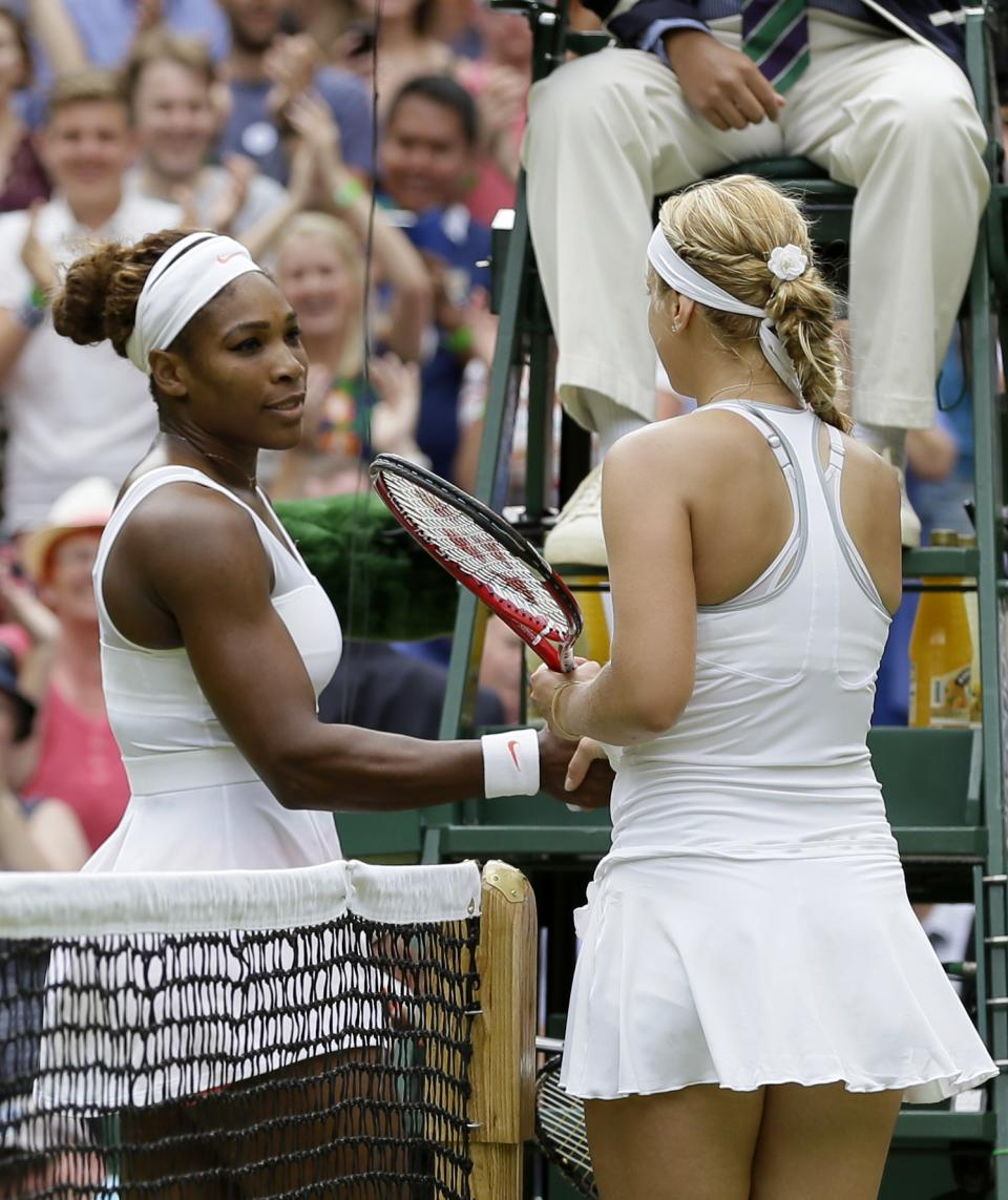 Sabine Lisicki of Germany greets Serena Williams of the United States at the net after winning their Women's singles match at the All England Lawn Tennis Championships in Wimbledon, London, Monday, July 1, 2013. (AP Photo/Alastair Grant)
