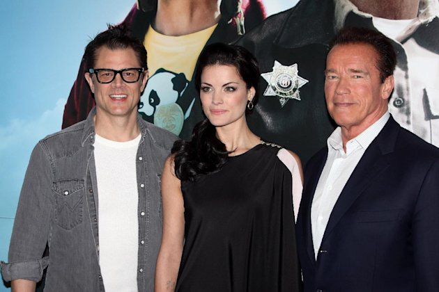 "From left, Johnny Knoxville, Jaimie Alexander and Arnold Schwarzenegger seen at a photo call for the film "" The Last Stand"" in London Tuesday Jan. 22. 2013 . (Photo by Jon Furniss Photography/Invision/AP)"
