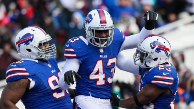 Buffalo Bills linebacker Bryan Scott (center) celebrates an interception during a Dec. 30 home game.