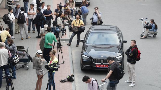 "Journalists stand next to Ecuador's Ambassador's car while waiting for the arrival of Edward Snowden, a former CIA employee who recently leaked top-secret documents about sweeping U.S. surveillance programs, at Sheremetyevo airport, just outside Moscow, Russia, Sunday, June 23, 2013. The former National Security Agency contractor, Snowdon is wanted by the United States for revealing two highly classified surveillance programs, but was allowed to leave Hong Kong for a ""third country"" because a U.S. extradition request did not fully comply with Hong Kong law, the territory's government said Sunday. (AP Photo / Alexander Zemlianichenko Jr)"
