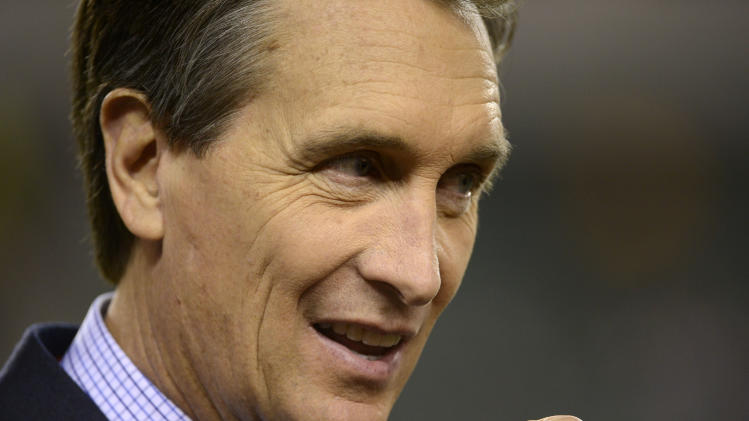 "FILE - This Oct. 21, 2012 file photo shows former Cincinnati Bengals receiver Cris Collinsworth prior to an NFL football game between the Bengals and Pittsburgh Steelers, in Cincinnati. Collinsworth figures his announcing career benefited from the fact he wasn't a household name as an NFL player. He learned from his mistakes calling games watched by small numbers of fans, slowly working his way up to his current high-profile gig on ""Sunday Night Football."" (AP Photo/Michael Keating, File)"
