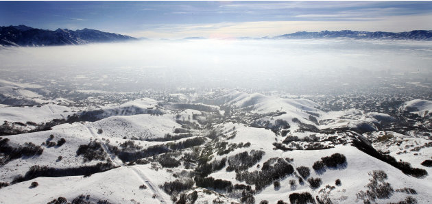 In this Jan. 9, 2013, photo, an inversion cloud covers downtown Salt Lake City.  A group of Utah doctors is declaring a health emergency over the Salt Lake City area's lingering air pollution problem.