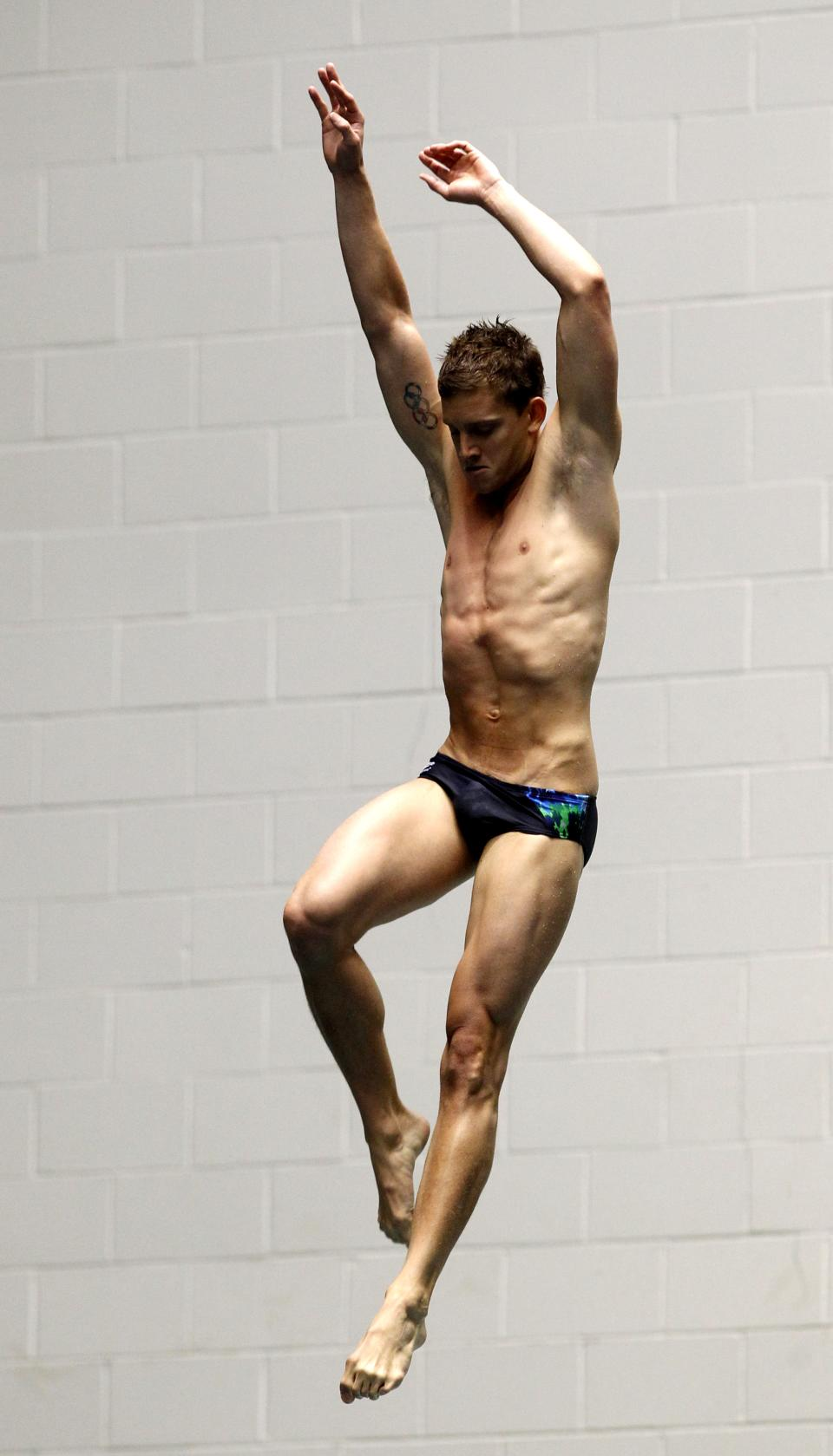 Chris Colwill begins his final dive in the men's 3-meter springboard final at the U.S. Olympic diving trials on Sunday, June 24, 2012, in Federal Way, Wash. Colwill won the event. (AP Photo/Elaine Thompson