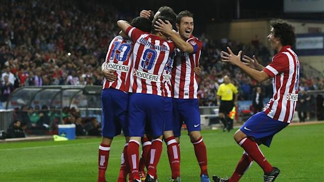 Atletico Madrid's players celebrate a goal during their Spanish first division soccer match against Betis at Vicente Calderon stadium October 27, 2013 (Reuters)