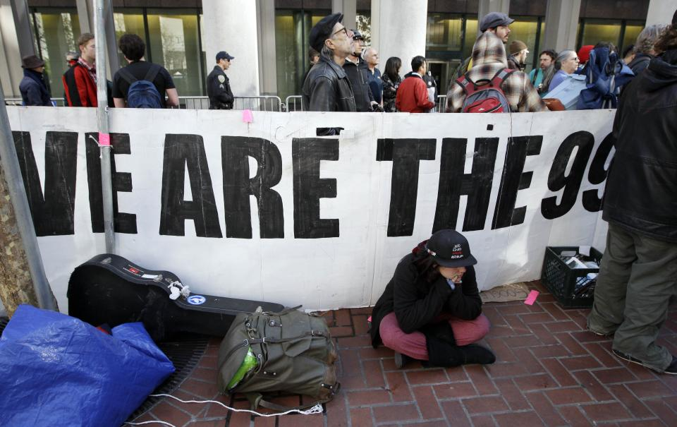 Occupy San Francisco demonstrators rally in San Francisco, Wednesday, Dec. 7, 2011 near the encampment that was closed by authorities earlier in the day. (AP Photo/Paul Sakuma)