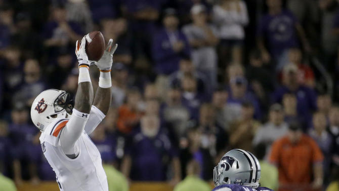 Auburn wide receiver D'haquille Williams (1) gets past Kansas State defensive back Danzel McDaniel (7) to catch a long pass during the second half of an NCAA college football game Thursday, Sept. 18, 2014, in Manhattan, Kan. Auburn won 20-14. (AP Photo/Charlie Riedel)