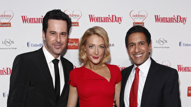 IMAGE DISTRIBUTED FOR CAMPBELL SOUP COMPANY - From left, actor Jonathan Silverman, actress Jennifer Finnigan, and Dr. Sanjay Gupta walk the red carpet during the Woman's Day Red Dress Awards on Tuesday, Feb. 12, 2013, in New York City. (Brian Ach/AP Images for Campbell Soup Company)