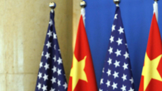 U.S. Vice President Joe Biden, left, speaks near Chinese Vice President Xi Jinping during talks held at a hotel in Beijing, China, Friday, Aug. 19, 2011. (AP Photo/Ng Han Guan, Pool)